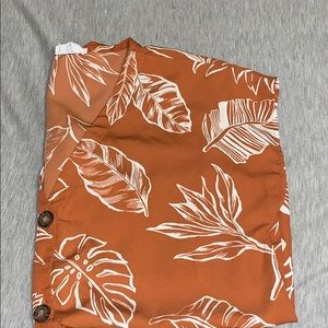 I'm selling a formal shirt with leaf patterns